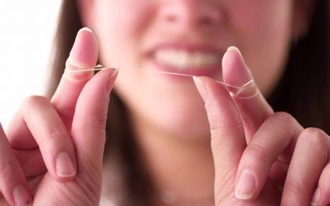 Jak nitkować zęby Sunstar GUM
